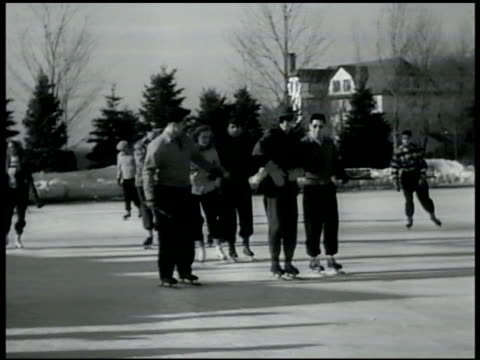 stockvideo's en b-roll-footage met ice skating rink in front of hotel snow covered ground people ice skating ext concord hotel int concord hotel lobby cu activities board catskill... - 1949