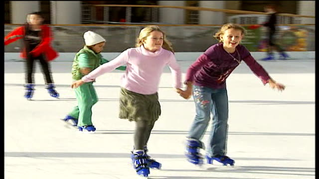 ice skating rink opens to the public at the old royal naval college in greenwich england london old royal naval college greenwich ice rink ext girls... - royal navy college greenwich stock videos & royalty-free footage