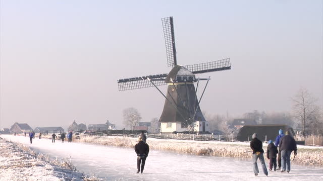 ice skating through the dutch polders - ice skating stock videos and b-roll footage