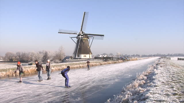 ice skating through the dutch polders - ice skating stock videos & royalty-free footage