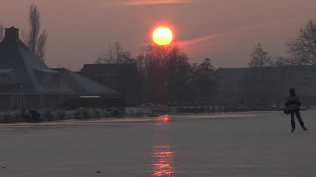 stockvideo's en b-roll-footage met ice skating through the dutch polders - kees van den burg