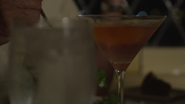 ice water and martini in restaurant - martini glass stock videos & royalty-free footage