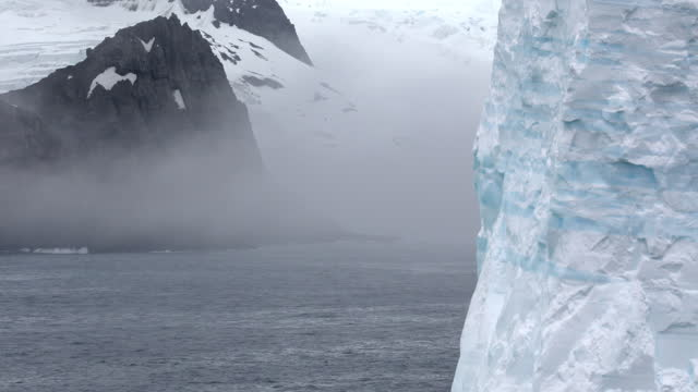 iceberg and snow covered coast - south pole stock videos & royalty-free footage