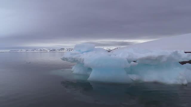 Iceberg, bergy bits, float past, Svalbard, Norway