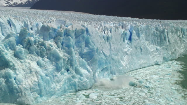 ws iceberg falling on water / perito moreno glacier, argentina - glacier stock videos & royalty-free footage