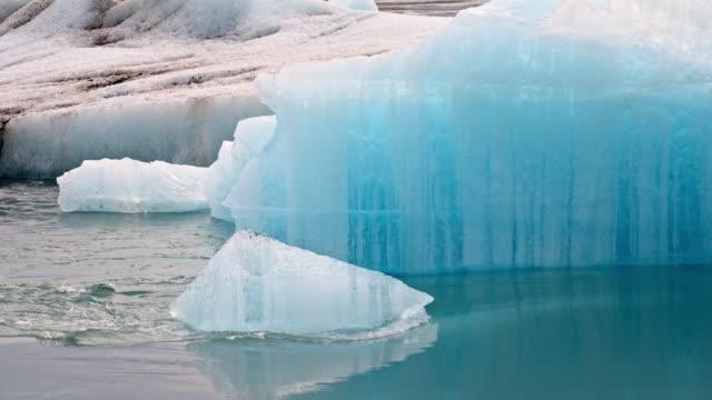 slo mo iceberg in jokulsarlon lagoon - iceberg ice formation stock videos & royalty-free footage