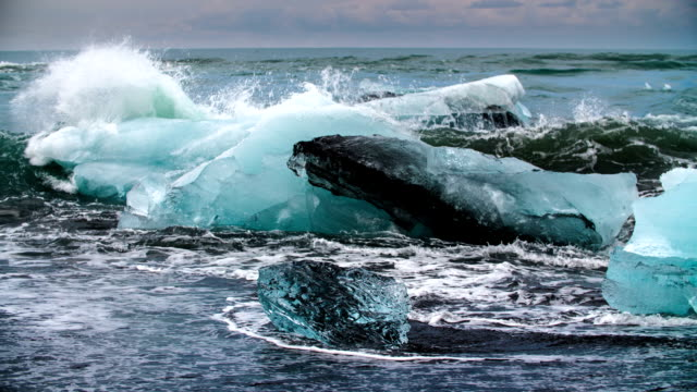 slow motion: iceberg in rough sea - arctic stock videos & royalty-free footage