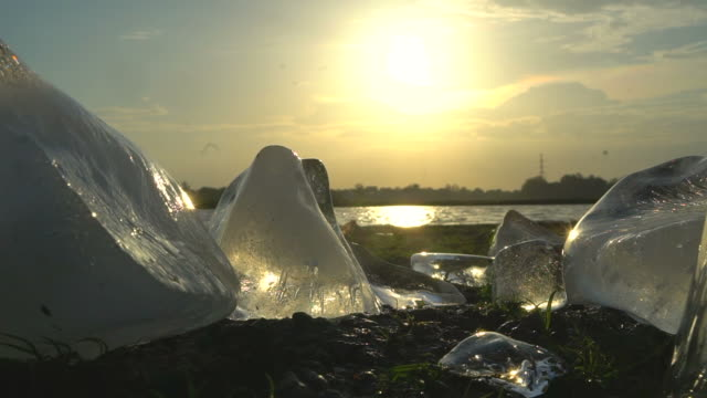 iceberg melting on the lagoon at sunset - polar stock videos & royalty-free footage