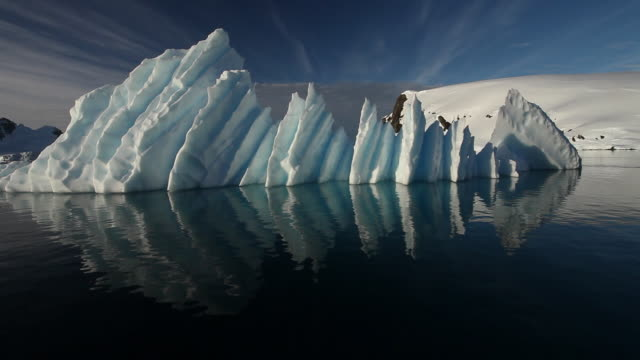 Iceberg, tracking around from boat and sunburst, Antarctica
