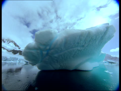 icebergs and clouds cast reflections in the antarctic ocean. - antarctic ocean stock videos & royalty-free footage