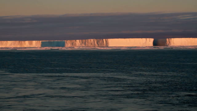 ws icebergs at sunset, antarctica - south pole stock videos and b-roll footage