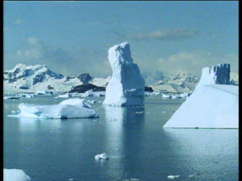 icebergs bob, float and drift under blue sky, antarctica - bbc archive stock-videos und b-roll-filmmaterial