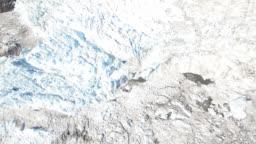 Icebergs broken up terminus of massive glacier