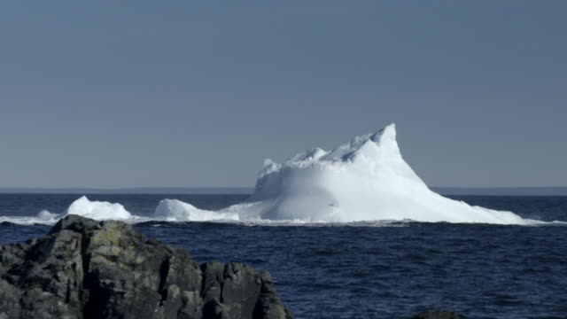 icebergs calving off the coast of newfoundland - emergencies and disasters stock videos & royalty-free footage