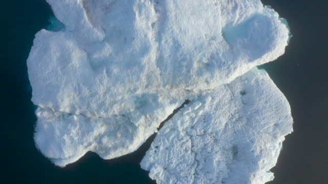 icebergs float in the ilulissat icefjord during a week of unseasonably warm weather on august 3 2019 near ilulissat greenland the sahara heat wave... - iceberg ice formation stock videos & royalty-free footage