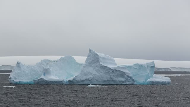 icebergs from a receding glacier in suspiros bay off joinville island just off the antarctic peninsular. the peninsular is one of the fastest warming places on the planet. - antarctic ocean stock videos and b-roll footage