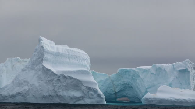 icebergs from a receding glacier in suspiros bay off joinville island just off the antarctic peninsular. the peninsular is one of the fastest warming places on the planet. - ice sheet stock videos & royalty-free footage