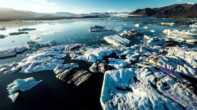 aerial: icebergs in arctic landscape - jokulsarlon iceland - melting stock videos & royalty-free footage
