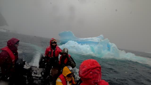 icebergs in paradise bay, antarctic peninsula, southern ocean - antarctic peninsula stock videos & royalty-free footage
