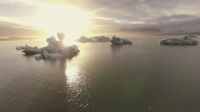 AERIAL Icebergs in the lagoon at sunset