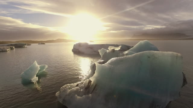 aerial icebergs in the lagoon at sunset - glacier stock videos & royalty-free footage