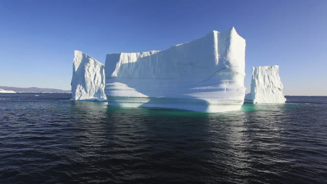 pov icebergs on calm water / greenland - arktis stock-videos und b-roll-filmmaterial