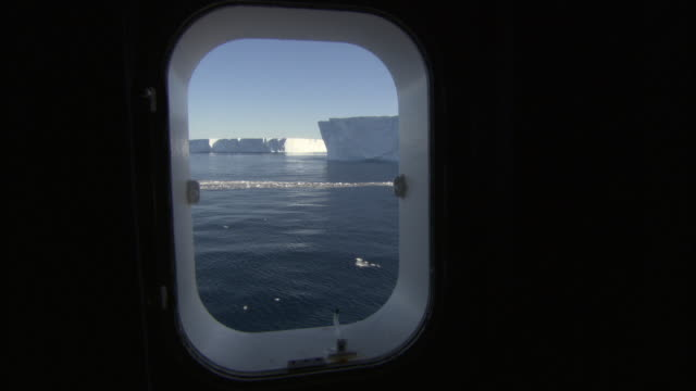 SIDE POV, Icebergs seen through ship window, Antarctica