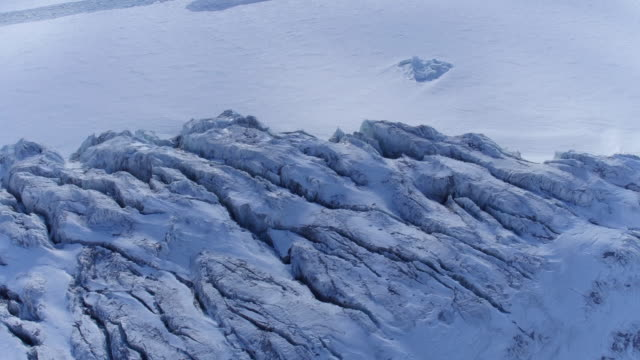 icebreaker in the middle of a glacier / antarctica - rough stock-videos und b-roll-filmmaterial