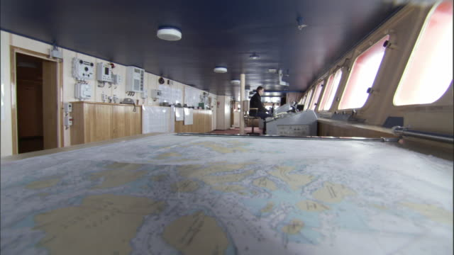 ws, icebreaker navigation bridge, map in foreground, russia - ship stock videos & royalty-free footage