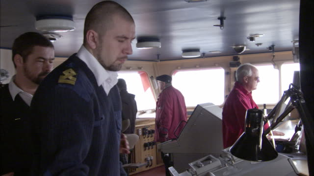 cu, tu, td, icebreaker officers in navigation bridge looking at navigation charts, russia - russia stock videos and b-roll footage
