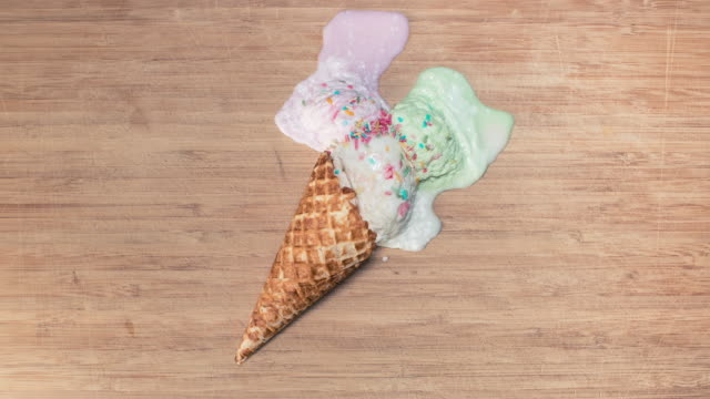 ice-cream cone melting on wooden background - waffle cone stock videos and b-roll footage