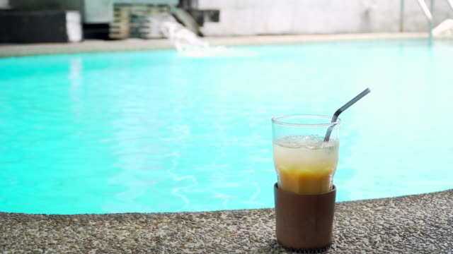 iced coffee drink with pool background - coffee drink stock videos & royalty-free footage