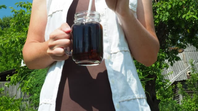 iced coffee in woman's hand - coffee drink stock videos & royalty-free footage