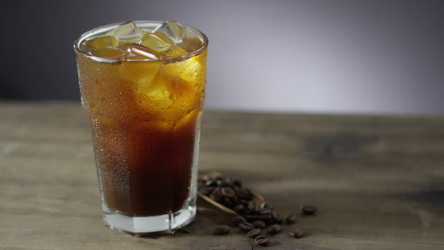 iced coffee on wooden table - condensation stock videos & royalty-free footage