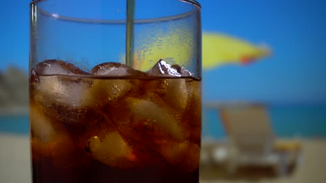iced cola on the beach on a sunny day - cola stock videos & royalty-free footage