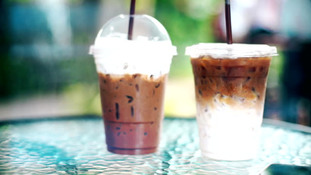 iced latte coffee and iced cocoa in a takeaway cup on the table in the cafe.
