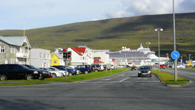 Iceland Akureyri downtown center second largest city traffic and cruise ship in background Glerargata Street