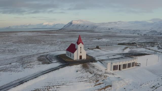 iceland church on snaefellsnes in winter - snäfellsnes stock-videos und b-roll-filmmaterial