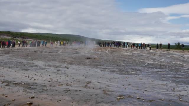 Iceland Haukadalur Strokkur geyser goes into eruption