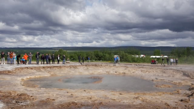 Iceland Haukadalur Strokkur geyser sucks water into the vent