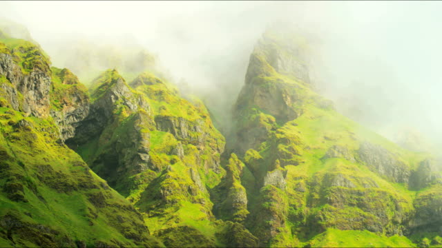 iceland mountain mist eco tourism rock cliffs travel - eco tourism stock videos & royalty-free footage