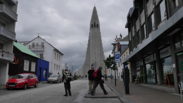 Iceland Reykjavik Hallgrimskirkja cathedral and people on shopping street
