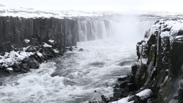 iceland selfoss waterfall in winter with snow - powerful stock videos and b-roll footage