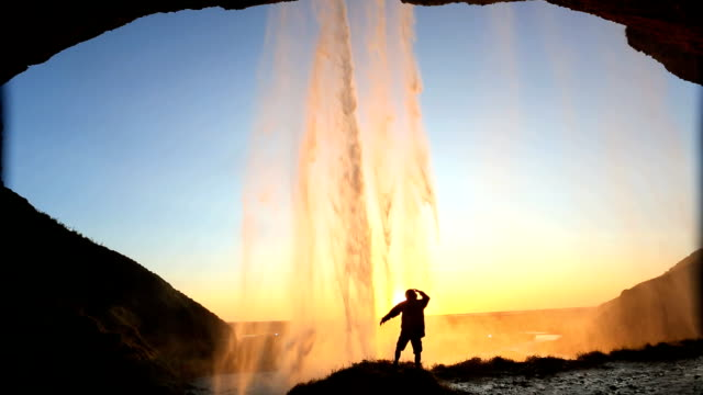 iceland seljalandsfoss sunset waterfall mist rock face cliff hiking - seljalandsfoss waterfall stock videos and b-roll footage
