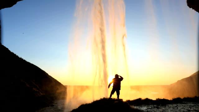Iceland Seljalandsfoss sunset Waterfall rock face cliff hiking