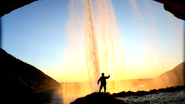 Iceland Skogafoss Waterfall sunset male nature rock face