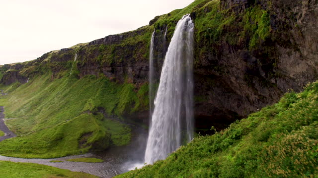 iceland waterfall aerial view - seljalandsfoss waterfall stock videos and b-roll footage