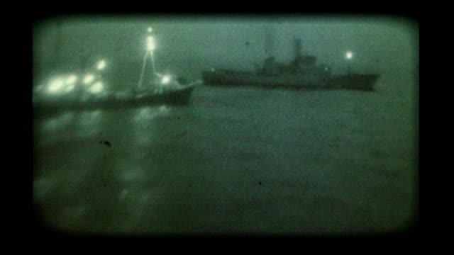 stockvideo's en b-roll-footage met british charities may lose out 1975 north atlantic ext royal navy patrol ship and icelandic fishing boat at sea during cod war - noord atlantische oceaan