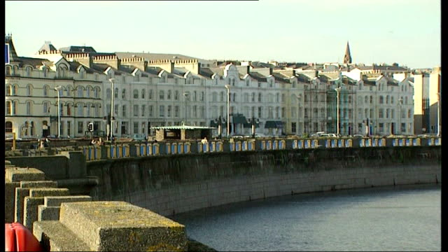 offshore savings at risk isle promenade and seafront houses of isle of man coastline - isle of man stock videos & royalty-free footage