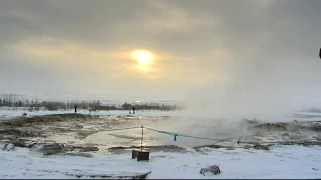 icelandic banking system collapse: seven councils accused of negligence; tx 3.2.2009 iceland: geyser erupting and steam rising from hot springs - geysir stock-videos und b-roll-filmmaterial